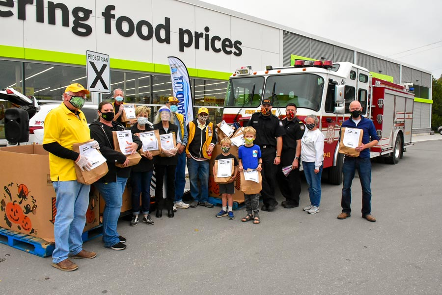 Food bank food drive a team effort, raising $2,700